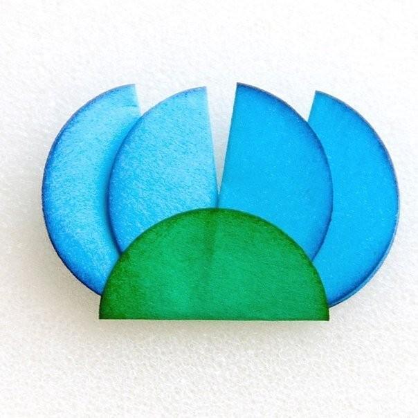 Делаем цветочки из бумажных кружков