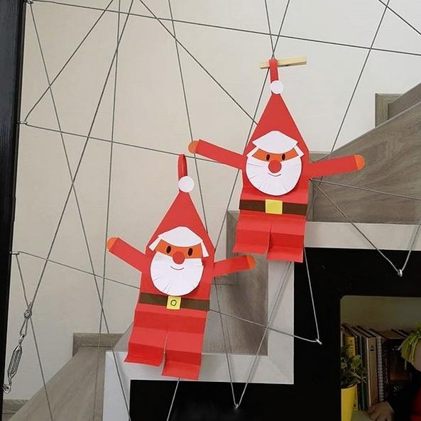 Веселый Дед Мороз из цветной бумаги 1