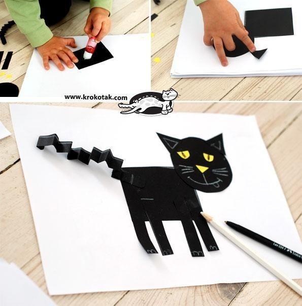 Черный кот с хвостом-гармошкой
