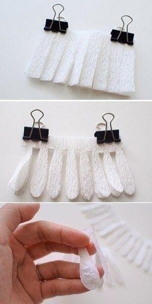 Ромашки из гофрированной бумаги и пряжи