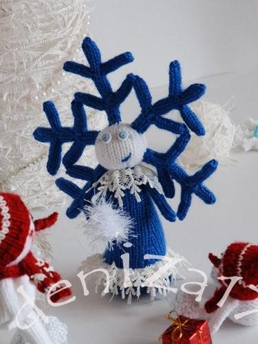 Вязание девочки-снежинки спицами